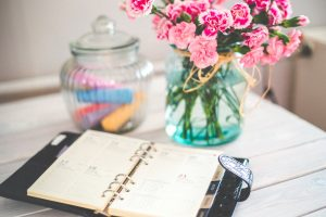 flowers and planner on desk - mom blog from home